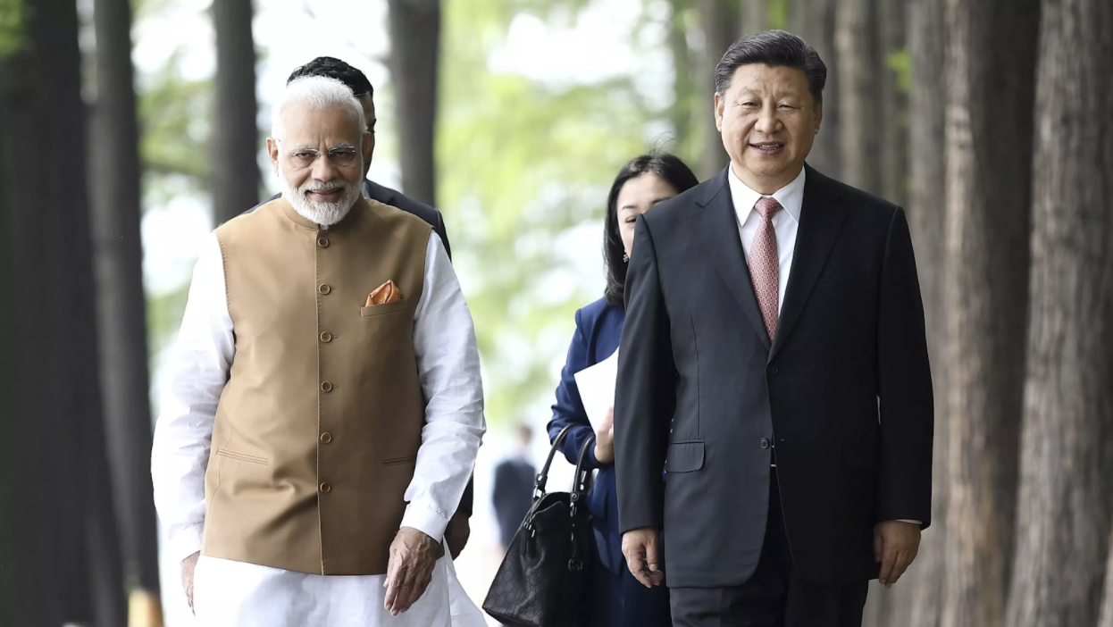 Indian Prime Minister Narendra Modi, left, and Chinese President Xi Jinping walk together in Wuhan, China, on April 28. Source: Xinhua/AP