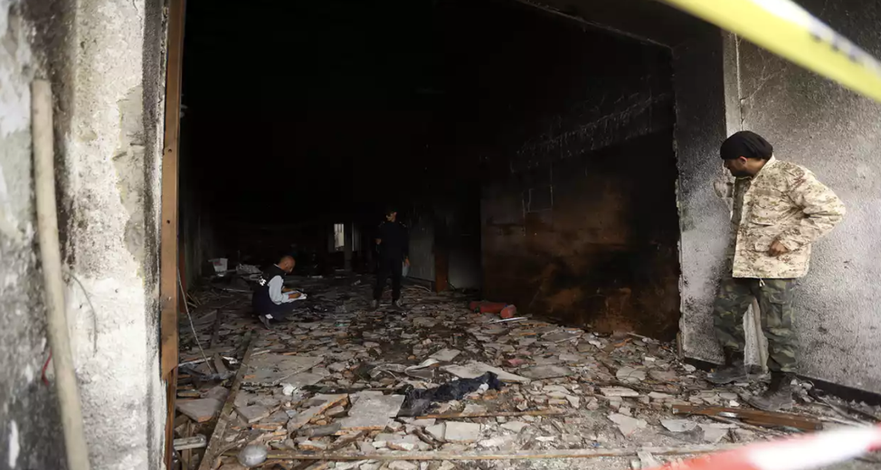 Libya's elections commission headquarters in Tripoli after a suicide bombing attack.  Source .