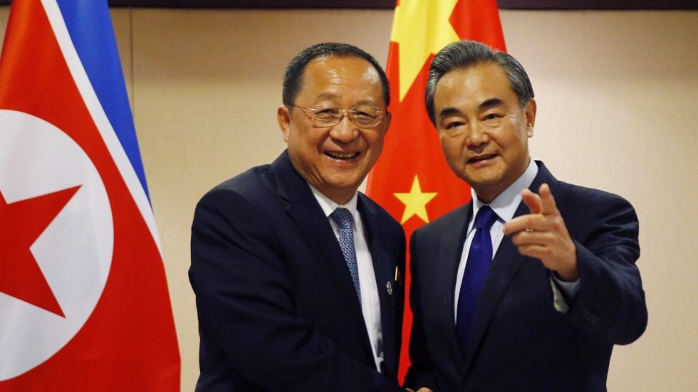(Photo: North Korea's foreign minister Ri Yong and China's foreign minister Wang Yi pose for a photo. Source:  AP )