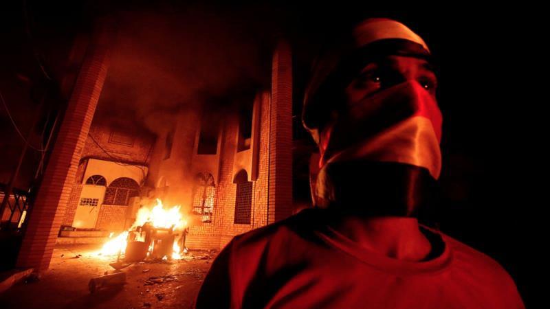 [Photo: A building burns in Basra, Iraq. Source: Reuters]