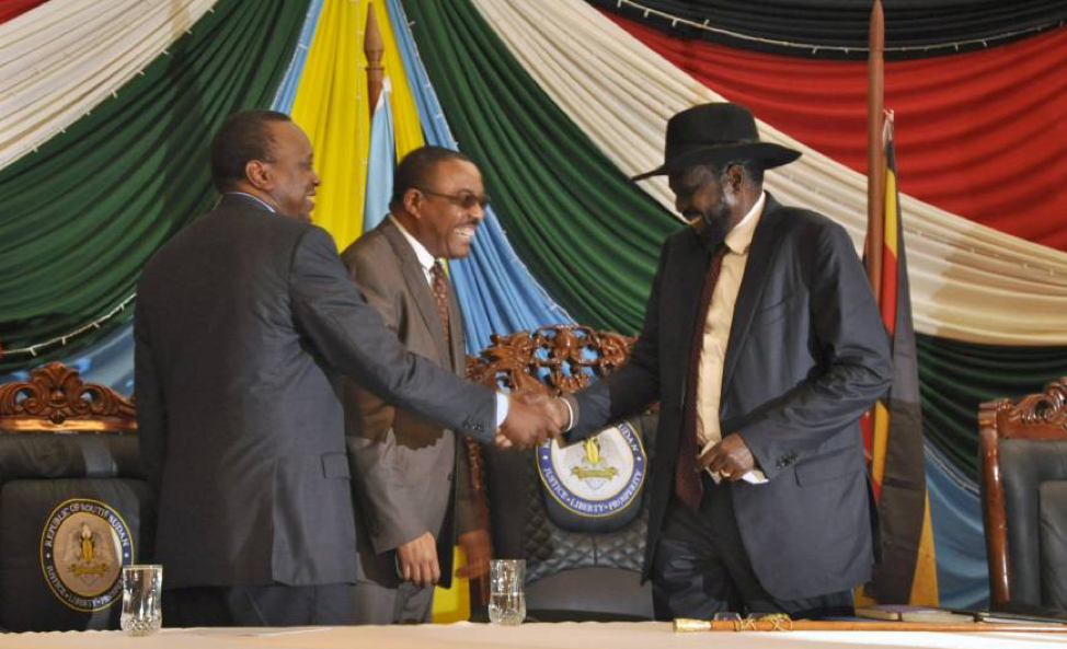 South Sudan's President Salva Kiir (right) shakes hands with Kenya's President Uhuru Kenyatta (left) and Ethiopia's Prime Minister Hailemariam Desalegn after signing a peace deal in Addis Ababa on Wednesday. Credit: Reuters via Japan Times.