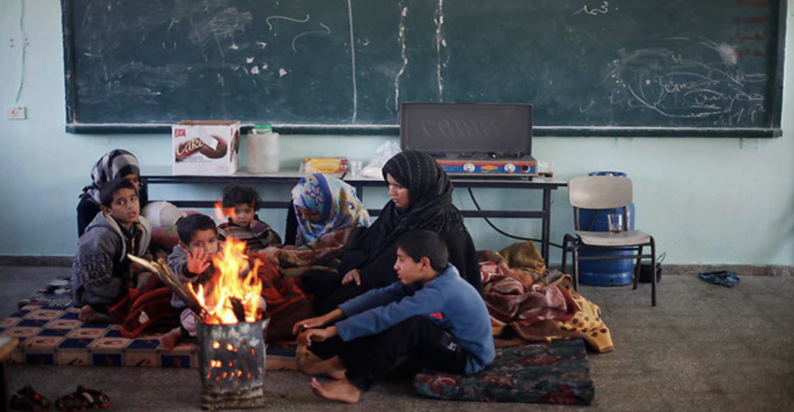 [Photo: Residents of Gaza without electricity during winter. Source:  Reuters ]