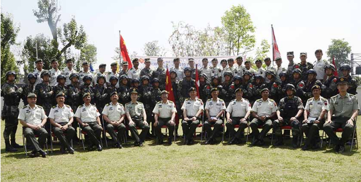 Nepalese and Chinese soldiers pose for a photograph during the 2017 edition of Sagarmatha Friendship Military Exercise. Photo: Nepal Army;  The Himalayan