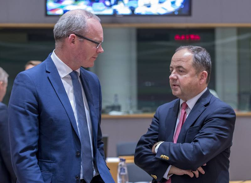 Irish Minister for Foreign Affairs and Trade Simon Coveney (left) and Polish Minister for European Affairs Konrad Szymanski chat during a break in a session of the General Affairs Council of the European Council on Sept. 18, 2018. Photo:  European Union