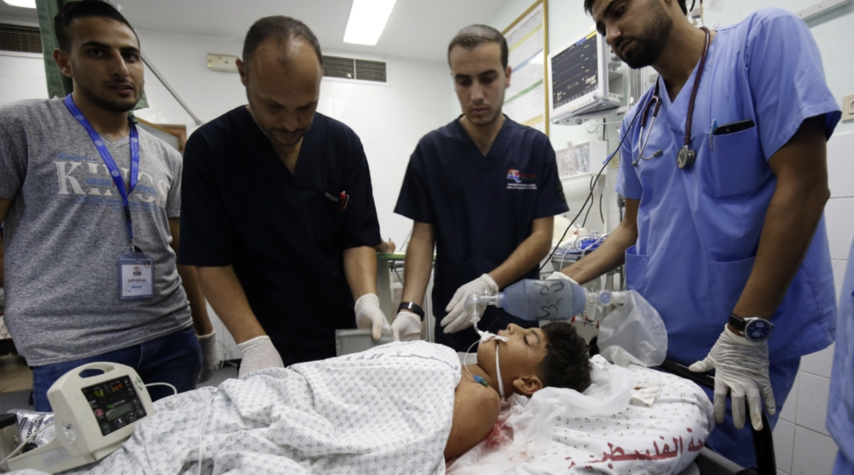 Youssef Abu Zarifa, a Palestinian boy, is treated for injuries from conflict on the Gaza border. Photo:  AFP