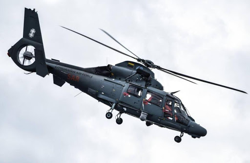 A Lithuanian Naval helicopter the AS-365 Dauphin responded to the ferry's distress call. Credit:    The Sun, A UK News Company