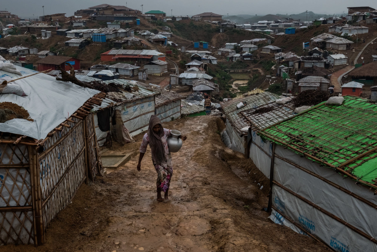 A Rohingya refugee carrying water through a refugee camp in Bangladesh.  Photo: Rebecca Conway, The New York Times