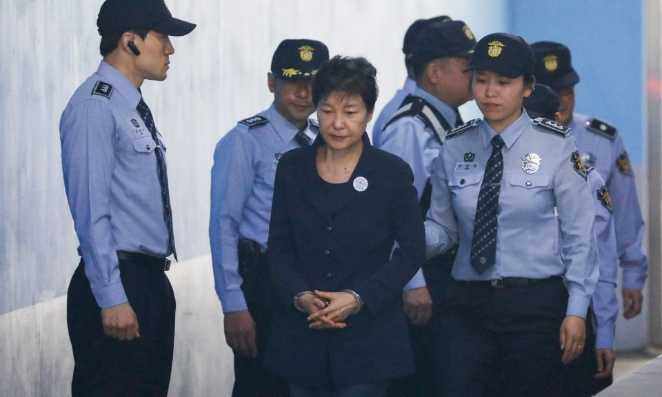 Lee Myung-bak's successor Park Geun-hye (center) faced similar charges and is currently serving a 33-year jail term. Photo:  AFP