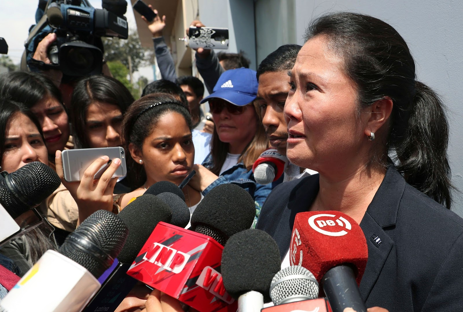 Keiko Fujimori cries in front of her father's home as she speaks to reporters on October 3. After Peru's Supreme court overturned a medical pardon for her father former President of Peru Alberto Fujimori  Photo: Martin Mejia/AP