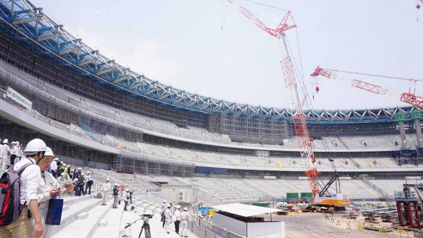 Members of the media tour the site of the New National Stadium, the main venue for the upcoming Games of the XXXII Olympiad, more commonly known as the Tokyo 2020 Olympic Summer Games, on July 18, 2018.  Photo: Magdalena Osumi/Japan Times
