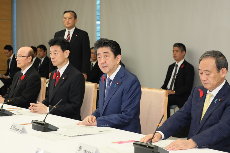 Prime Minister Shinzo Abe (center) speaks at the first meeting of the government committee organizing the Imperial succession ceremonies at the Prime Minister's Office on Friday, Oct. 12, 2018. Credit:  Prime Minister of Japan and His Cabinet