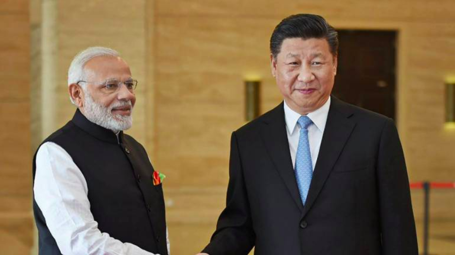 Indian Prime Minister Narendra Modi shaking hands with Chinese Leader Xi Jinping; Photo:  MoneyControl