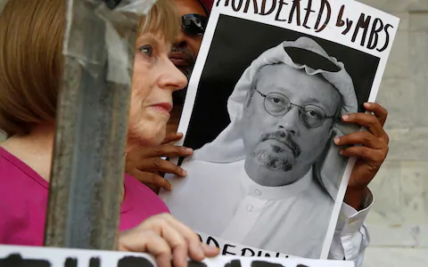 People hold signs during a protest at Washington's Saudi Arabian Embassy about the disappearance of Saudi journalist Jamal Khashoggi  Credit: AP
