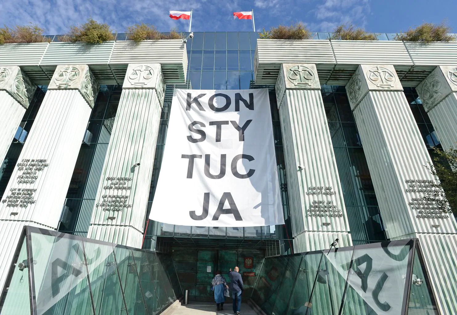 """A banner reading """"CONSTITUTION"""" — protesting the judicial reforms undertaken by the governing Law and Justice Party — hangs at the Supreme Court building in Warsaw on Oct. 11, 2018. Photo:  Alik Keplicz/AP"""