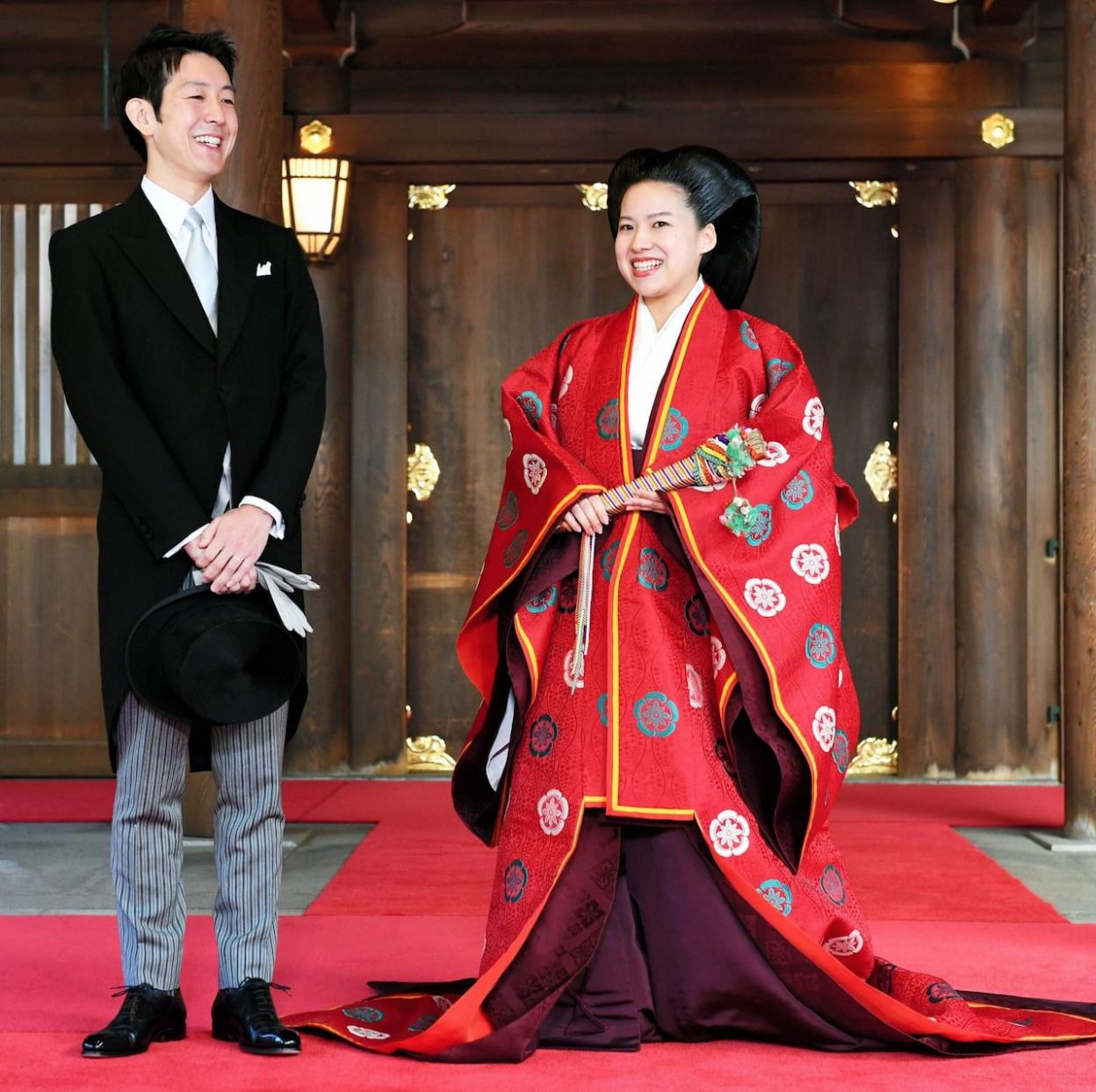Japanese Princess Ayako clothed in ceremonial wedding attire (right) standing next to her groom Kei Moriya (left) at their wedding on Monday 29, October 2018. Credit:  THE ASAHI SHIMBUN