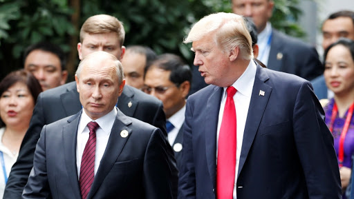 U.S. President Donald Trump and Russian President Vladimir Putin talk.    Credit: Jorge Silva/Reuters/File Photo