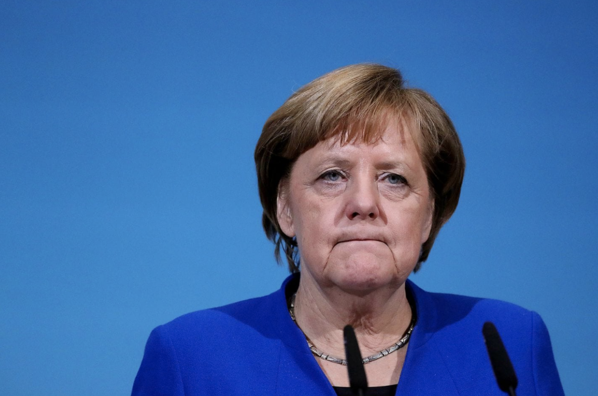 Angela Merkel announces she will not seek re-election. Photo:  Krisztian Bocsi/Bloomberg News