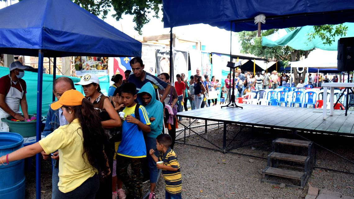 Venezuelan migrants line up for free meals in Cucuta, Colombia. Credit:  miamiherald