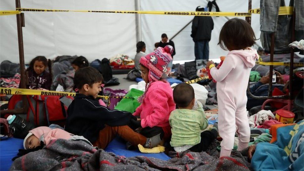 "Young migrant children at the Jesús Martínez ""Palillo"" sports stadium in Mexico City, a temporary shelter for members of the caravan to rest on their journey to the U.S.  Credit: EPA via BBC"