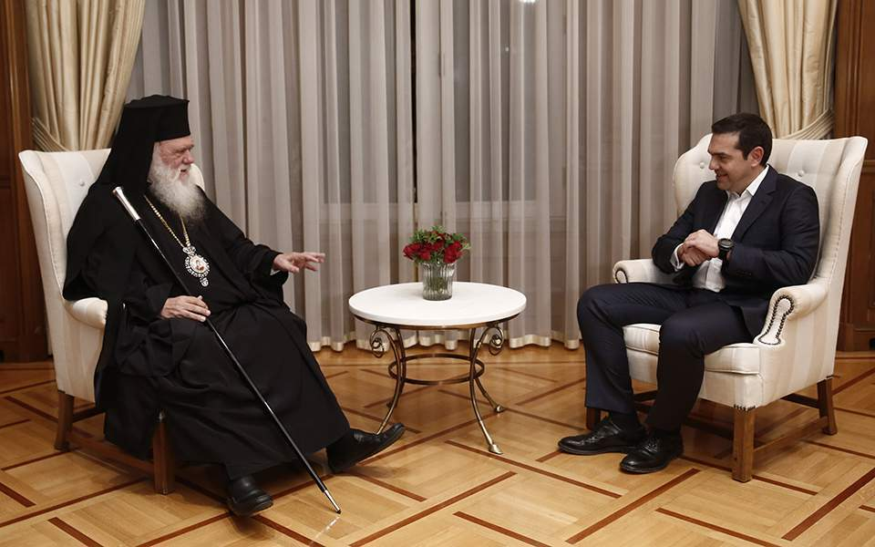 Archbishop of Athens and All Greece Ieronymos (left) chats with Prime Minister of Greece Alexis Tsipras. Credit:  ekathimerini.com