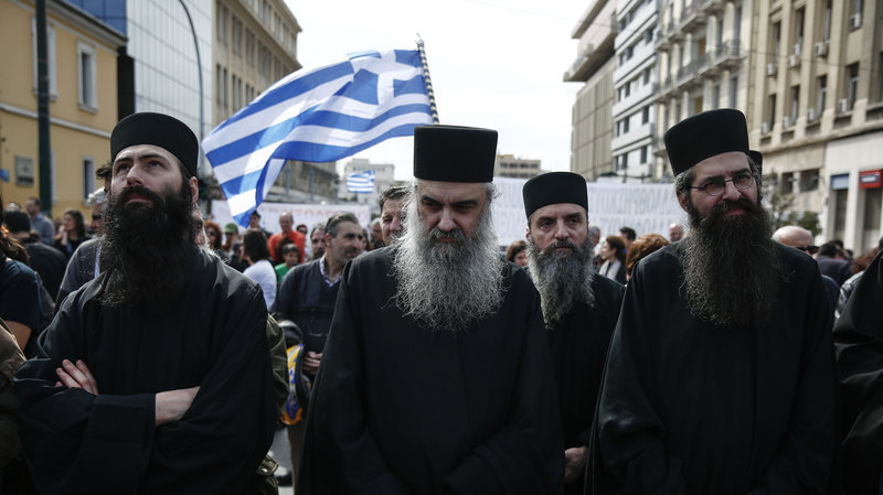 Greek clergymen at a rally in Athens held earlier this year. Credit:  Yorgos Karahalis/AP