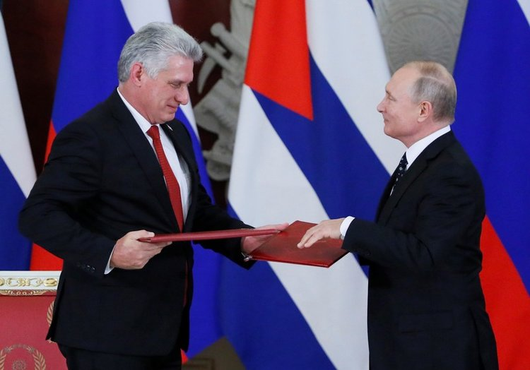Russian President Putin and Cuban President Diaz-Canel at a joint press conference following their meeting in Moscow. Credit:  Business Insider