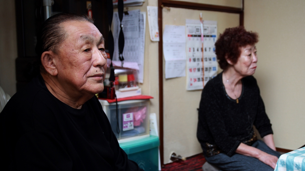 Kikuo Kojima (left), one of the 25,000 victims of forced sterilization by the government, remained silent on the matter for 57 years before telling his wife Reiko. Credit:  Al Jazeera