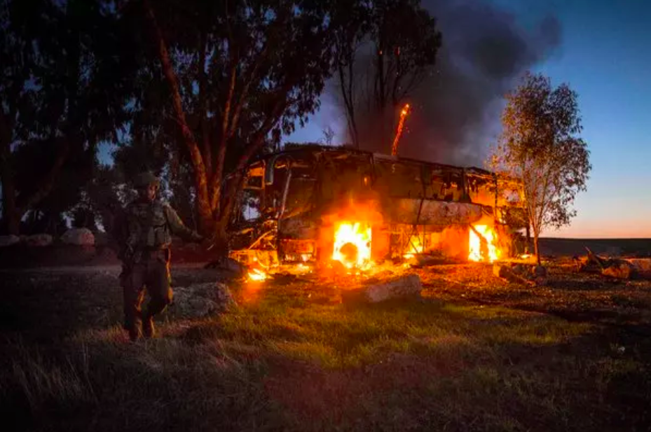 A bus burns in Israel on Monday after it was hit in a rocket and mortar attack from the Gaza Strip, Tsafrir Abayov. New York Times, Nov 12, 2018