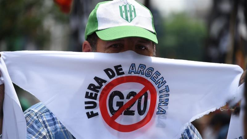 A protester in Buenos Aires, calling for the G20 to leave Argentina. Protestors are marching against the G20's economic policies as Argentina faces a deep recession. Photo:  Martin Bernetti/AFP via Al Jazeera .