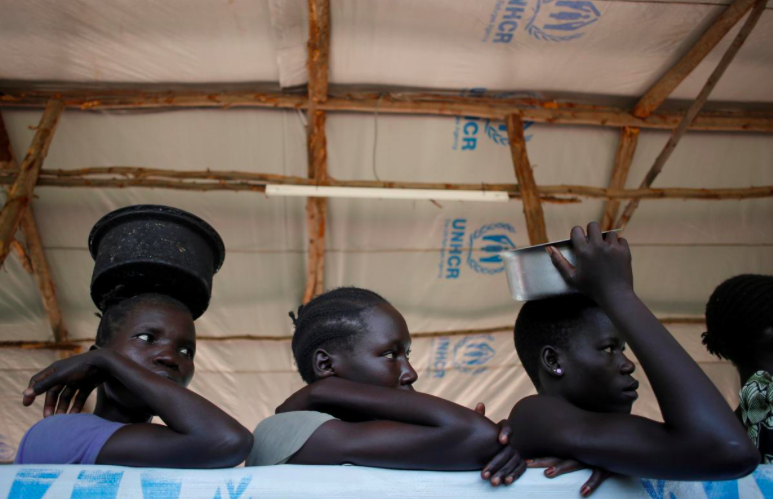 On Aug. 23, 2017, a line of South Sudanese refugees wait for food in Omugo refugee settlement camp in northern Uganda. Credit: Goran Tomasevic/ Reuters