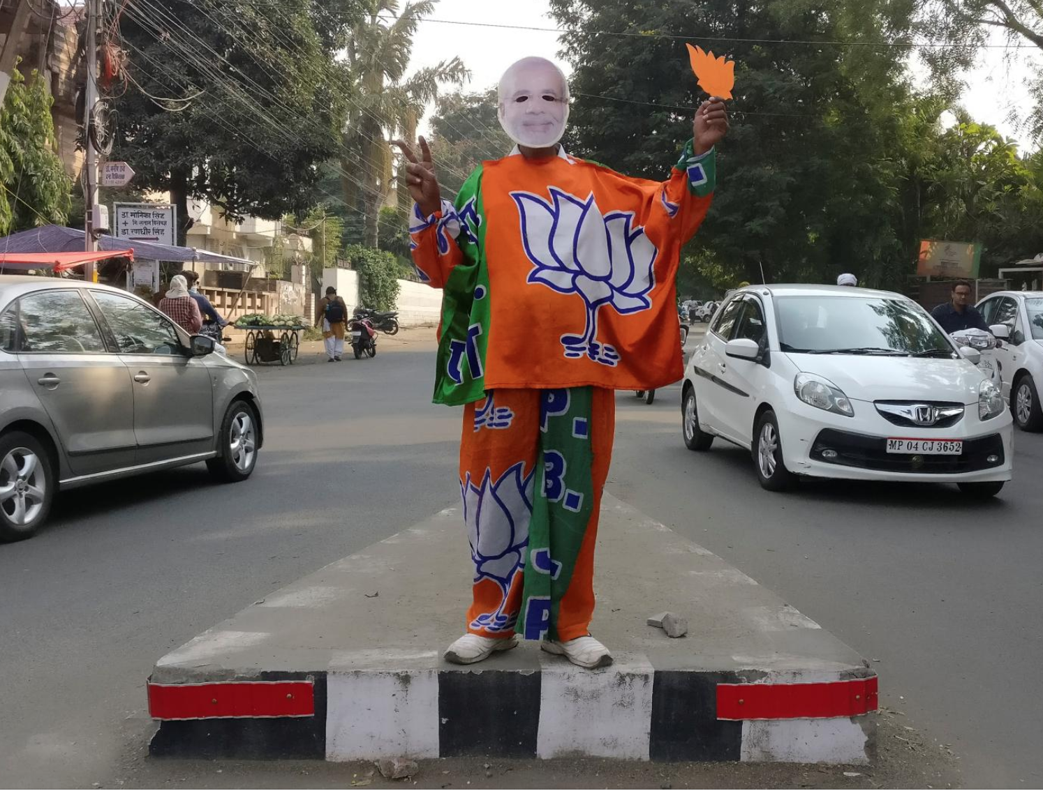 A supporter of the BJP party dresses as Prime Minister Modi in Bhopal, Madhya Pradesh, India. Photo:  Rajendra Jadha/Reuters