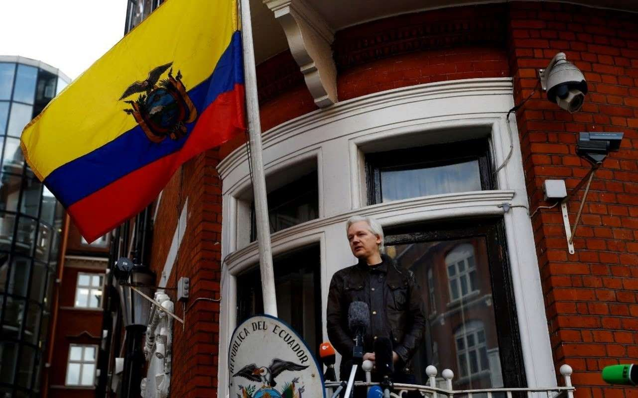 Assange on the balcony of the Ecuador embassy 2017  Photo:  Peter Nicholls/Reuters