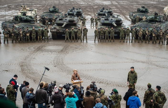"German Defense Minister Ursula von der Leyen holds a press conference in front of Leopard 2 tanks and ""Puma"" armored personnel carriers at Munster Training Area in the northwestern German state of Lower Saxony on Dec. 6. Photo:  dpa ."