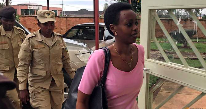 On Nov. 7, 2017, Police officers escort Rwigara into a courtroom in Kigali, Rwanda. Credit: Jean Bizimana/ Reuters via Channel News Asia