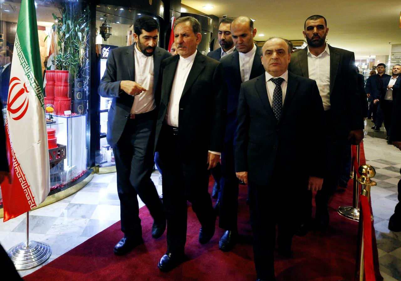Iranian Vice President Eshaq Jahangiri and Syrian Prime Minister Imad Khamis walk together after attending an Iranian-Syrian business forum in Damascus.  Credits: Reuters/Omar Sanadiki