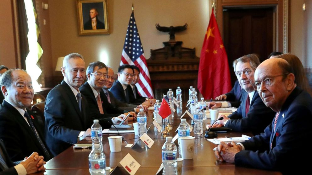 PRC Vice Premier Liu He (second from left) meets US Trade Representative Robert Lighthizer (second from right) at the opening of US-China trade talks at the White House on Jan. 30, 2019.  Photo:  Leah Millis/Reuters