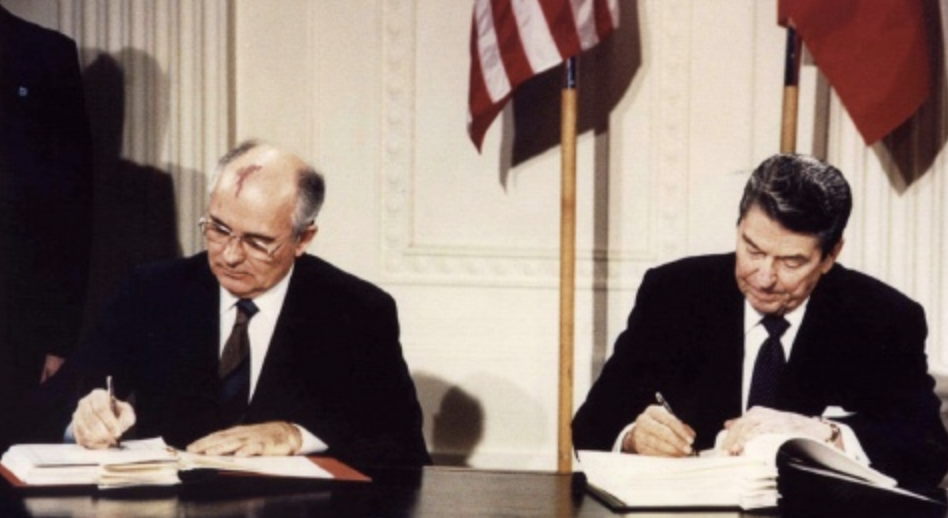 Former President Ronald Reagan and former Union General Secretary Mikhail Gorbachev signing the INF treaty in 1987. Credit:  Reuters