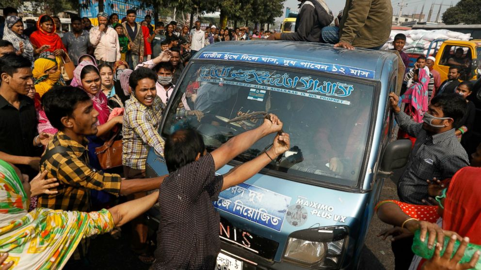 Bangladeshi protesters vandalizing a vehicle during the January 9, 2019 protest in Savar; Photo:  ABC News , Associated Press