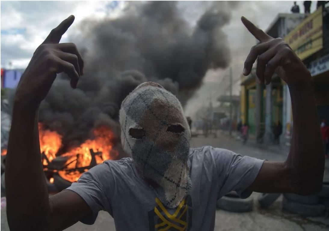A masked demonstrator in Port-au-Prince  Source: AFP/  Independent