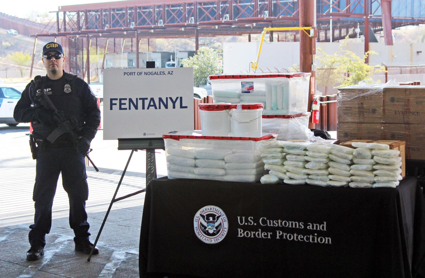 A U.S. Customs and Border Protection agent stands next to the largest seizure of fentanyl in the US, valued at over $3.5 million. Photo:  Nick Phillips/Nogales International .