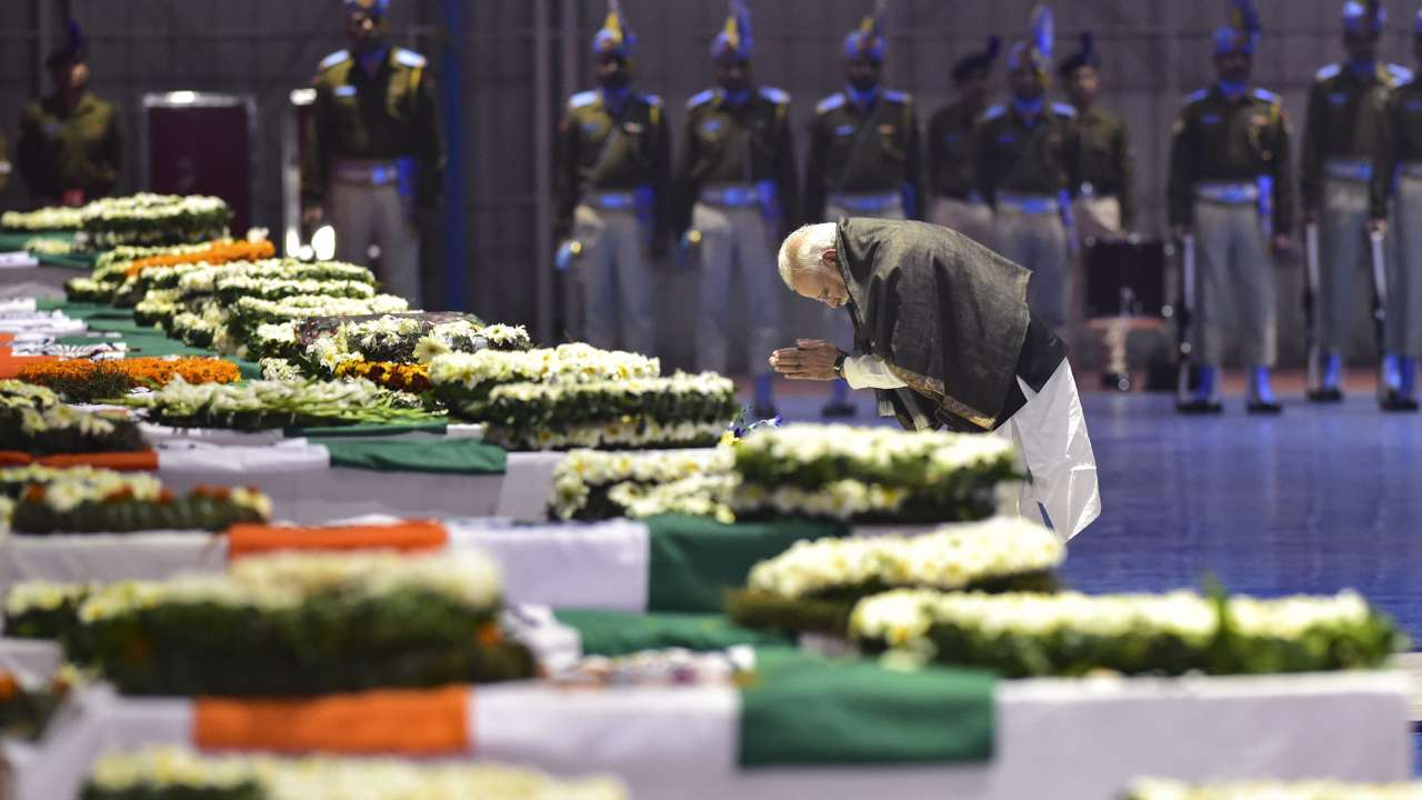 Indian Prime Minister Narendra Modi pays his last respects to the martyred CRPF personnel during the funeral ceremony at Palam Air Force Base in New Delhi on Friday, Feb. 15. Credit:  DNA