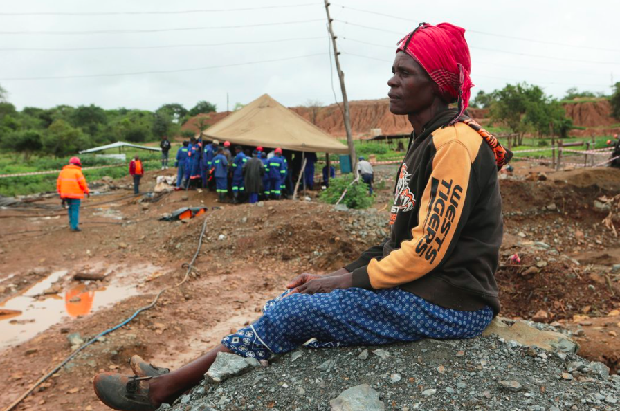 A women, Mary Zindege, waits to hear news about her son, one of the men trapped by the flood. Credit: Tsvangirayi Mukwazhi/ Time via AP