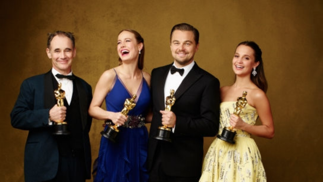Pictured [left to right]: Mark Rylance, Brie Larson, Leonardo DiCaprio, and Alicia Vikander with their statuettes after the ceremony in 2016. Photo:  WQBE