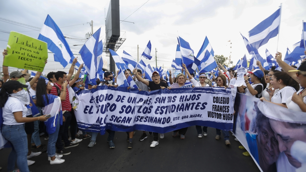 "Protestors hold a banner in Managua, Nicaragua's capital, which reads ""The future of a country is its children, the future is its students, stop killing them."" Photo: Alfredo Zuniga/AP."