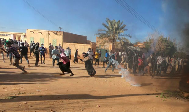 At a protest in January, riot police fire teargas to break up Sudanese demonstrators. Photo: Mohamed Nureldin Abdallah/ The Guardian via Reuters