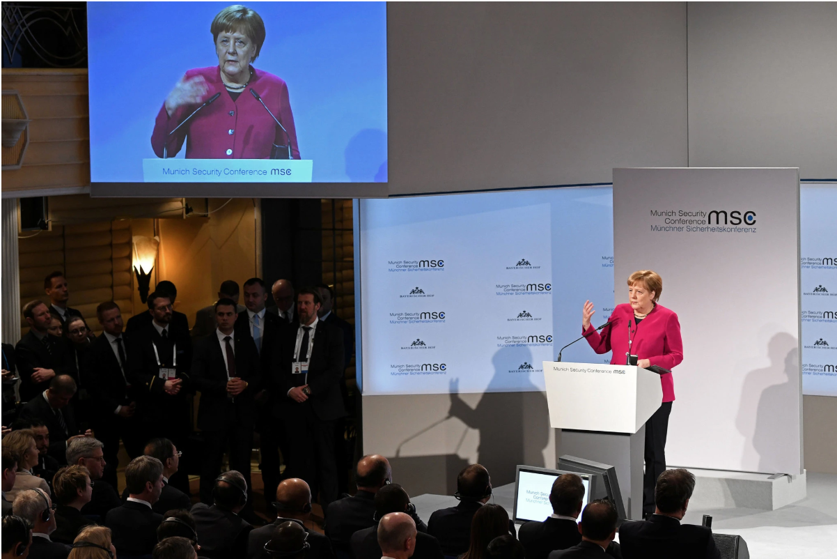 Chancellor Merkel giving what was potentially her last speech at the Munich Conference. Photo: Andreas Gebert/ Reuters