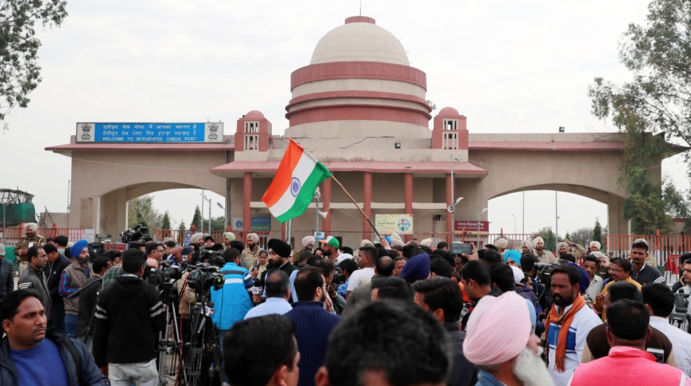 Civilians and media teams gather at the Wagah-Attari border for the return of Varthaman on Friday, March 1.  Photo:  Danish Siddiqui/Reuters