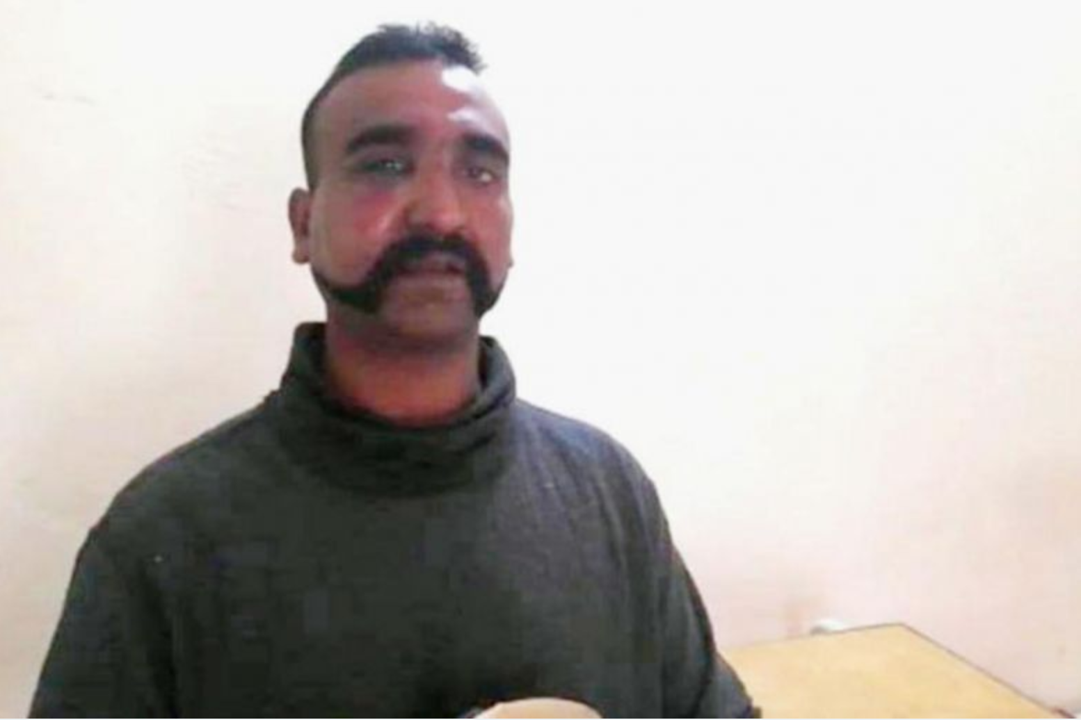 Wing Commander Abhinandan Varthaman seen in a video discussing his treatment by the Pakistani military.  Photo:  Straits Times via Reuters