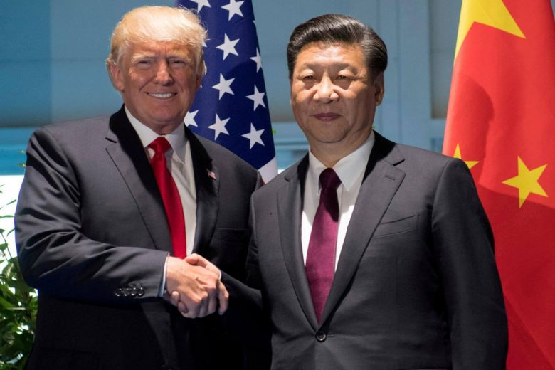 President Trump shakes hands with Chinese Premier Xi Jinping during a meeting in 2016  Photo:  Straits Times via Reuters