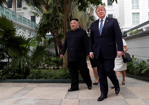 North Korean leader Kim Jong-un and US President Donald Trump walk in the garden of Hanoi's Metropole hotel shortly before the abrupt termination of the summit on Feb. 28, 2019.  Photo:  Leah Millis/Reuters